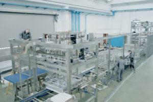 GEA technicians assembling a cupcake production line.jpg