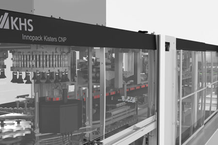 KHS develops new machine processing can toppers made of cardboard