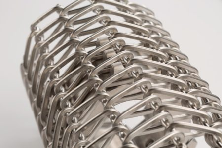 """Breaded food processors: """"shaped"""" wire belt lasts up to eight times longer"""