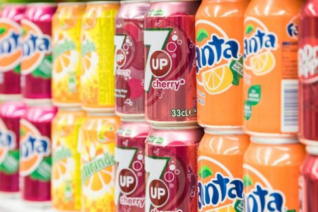 Sugar levels in UK soft drinks lowered following government levy